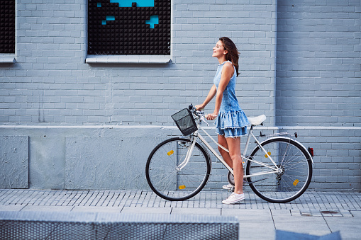 Woman on bike trip in the city during summer