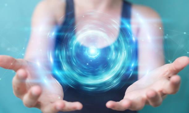 woman on blurred background creating new futuristic energy power source 3d rendering - potęga w naturze zdjęcia i obrazy z banku zdjęć