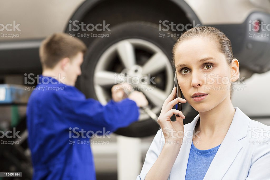 Woman On Call In Garage royalty-free stock photo