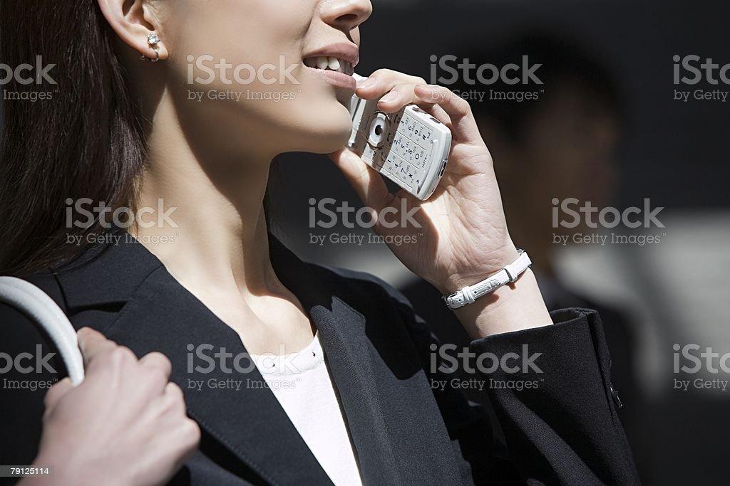 Woman on cellphone 免版稅 stock photo