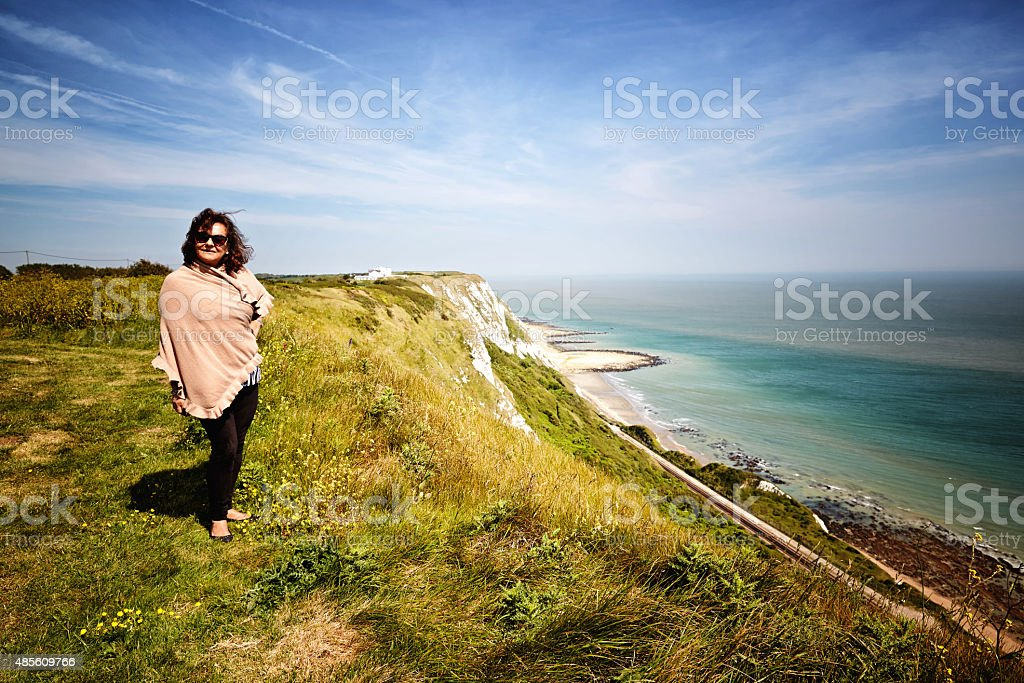 Woman on Chalk cliffs from the headland above Dover stock photo
