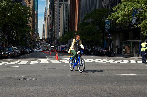 Woman on Citi Bike, E.42nd Street, Midtown Manhattan, NYC stock photo