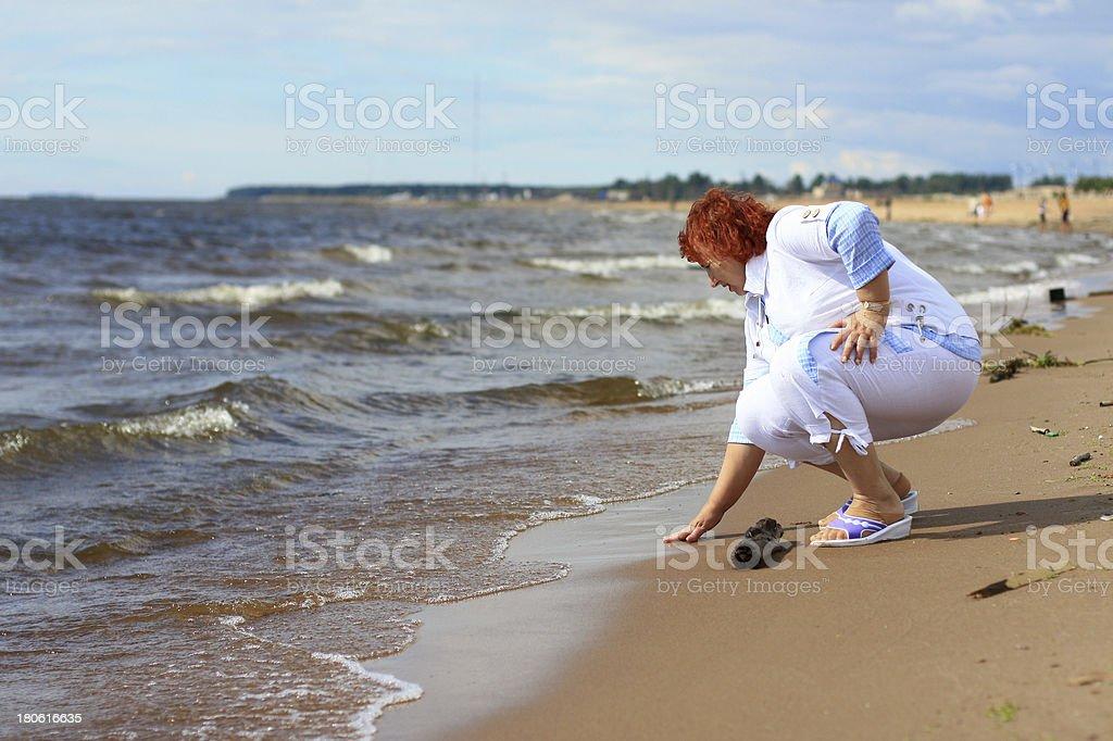 Woman on coast royalty-free stock photo