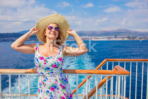 Blonde woman relaxing on cruise ship on summer day