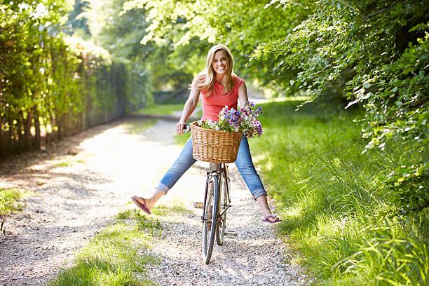 Woman on cycle ride in countryside picture id461264855?b=1&k=6&m=461264855&s=612x612&w=0&h=onq6unruhqn5v nip8gbdudydikfxobehecnkmsa4qs=