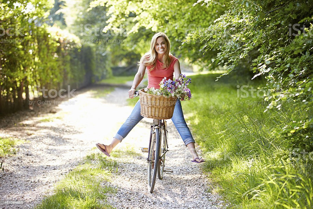 Woman On Cycle Ride In Countryside stock photo