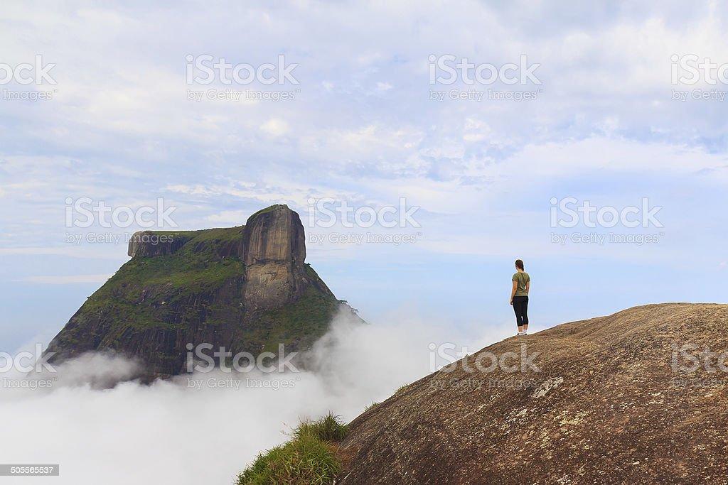 Woman on edge of mountain Rio de Janeiro stock photo