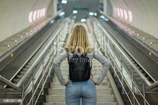 Woman on escalator in subway station