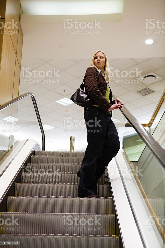 Woman on escalator royalty-free stock photo