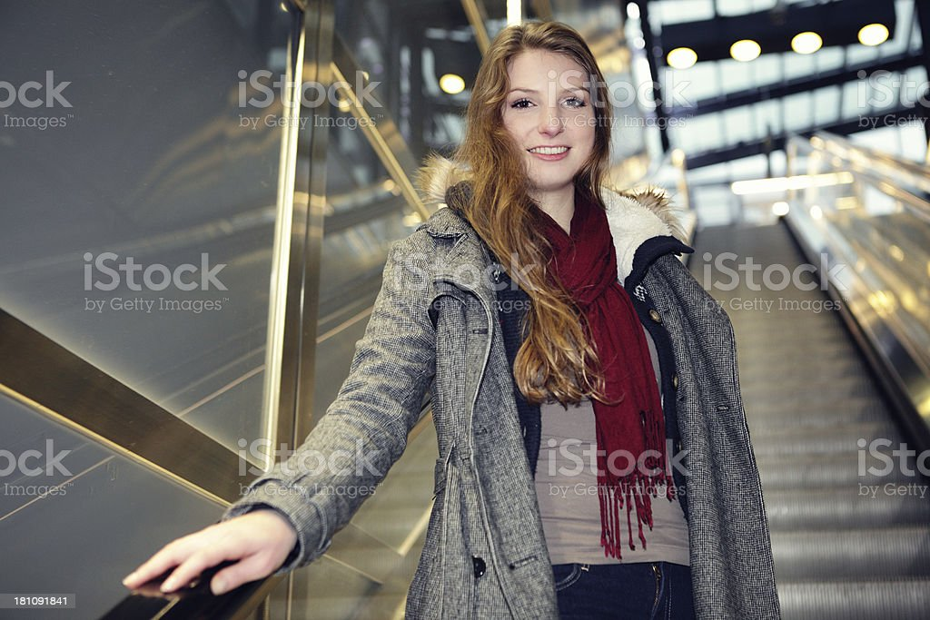 woman on escalator royalty-free stock photo