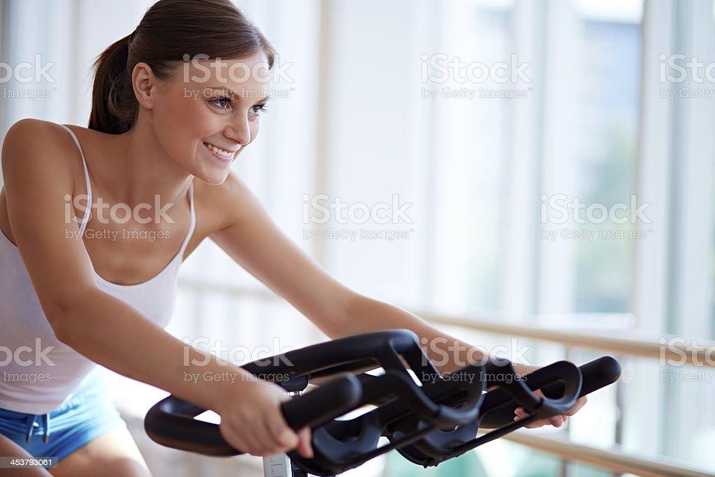 Woman on exercise machine royalty-free stock photo