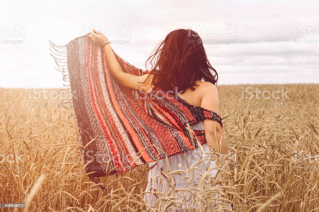 woman on field stock photo