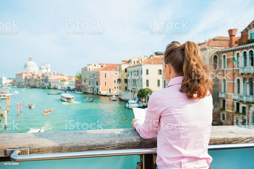Woman on Grand Canal in Venice stock photo