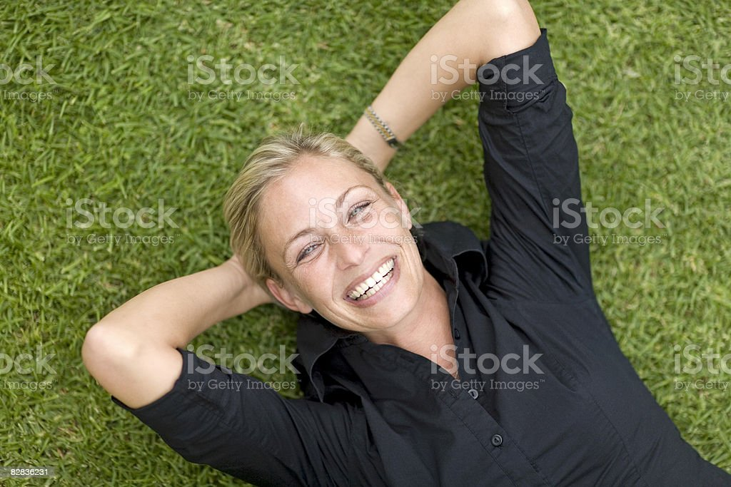 woman on grass zbiór zdjęć royalty-free