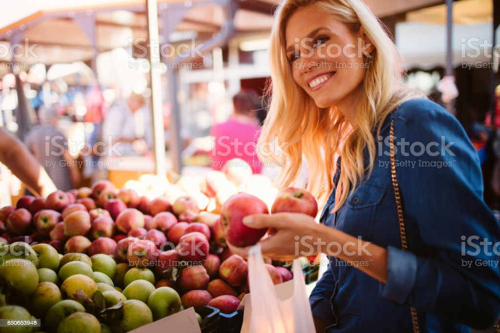 Woman on greenmarket stock photo