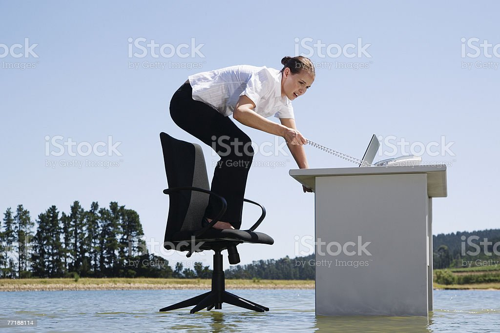 A woman on her office chair on top of water royalty-free stock photo