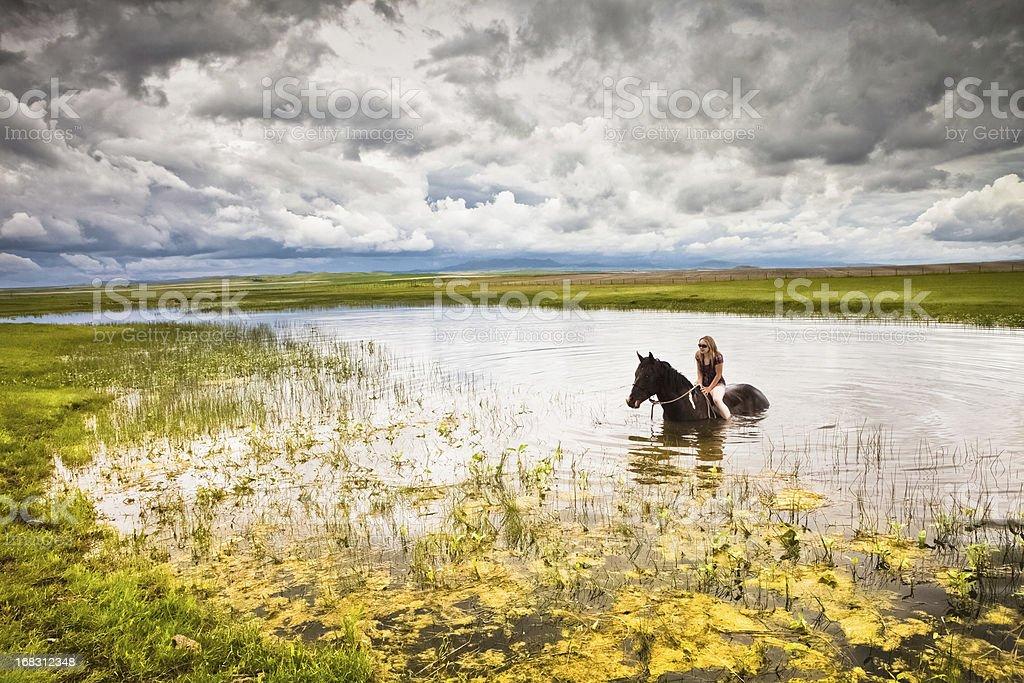 Woman On Horseback & Storm Coming stock photo