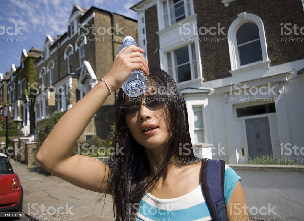 Woman on hot streets needs to cool down stock photo