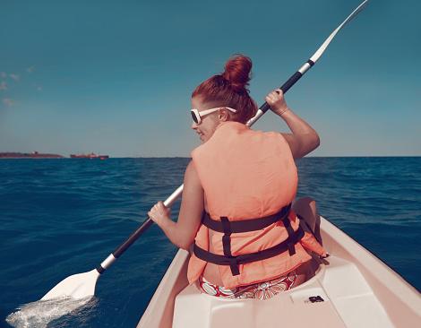 woman on kayac