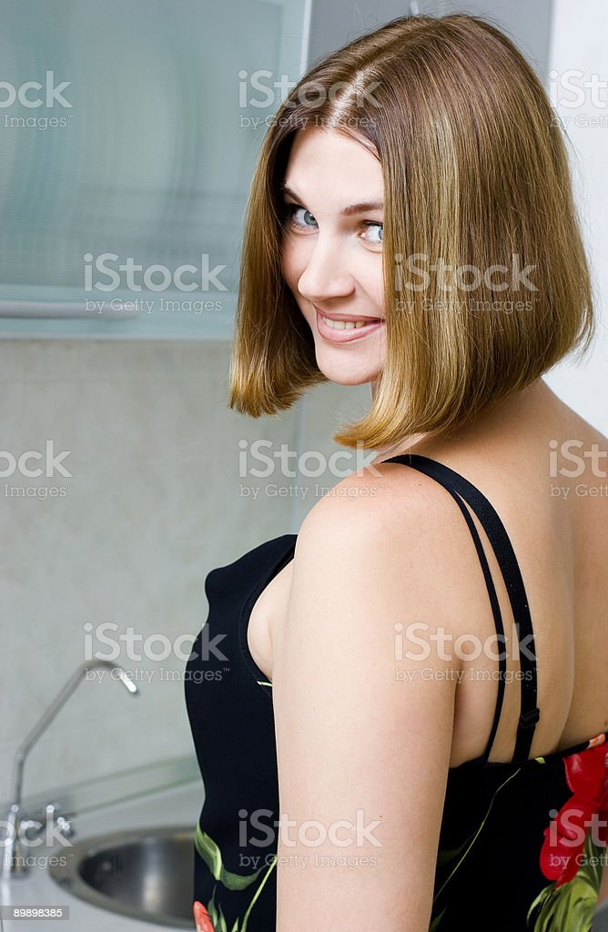 Woman on kitchen royalty-free stock photo