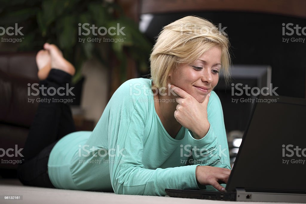 Woman on laptop working from home royalty-free stock photo