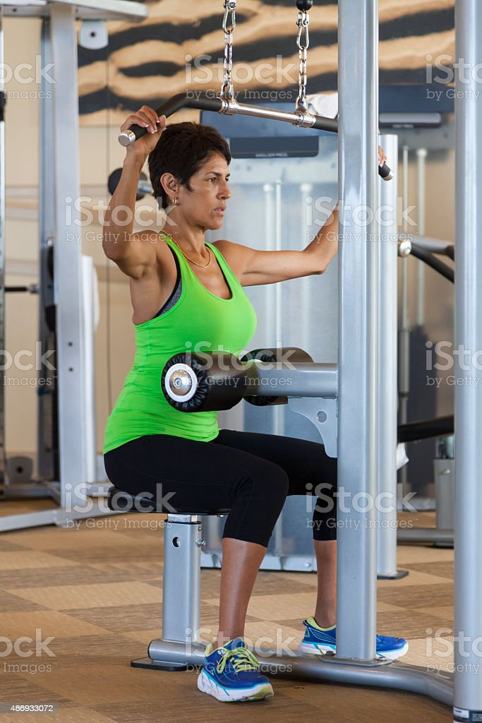 Woman on lat machine stock photo