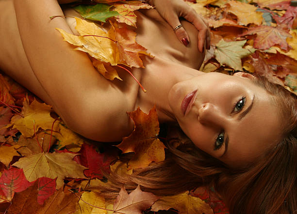 woman on leaves stock photo