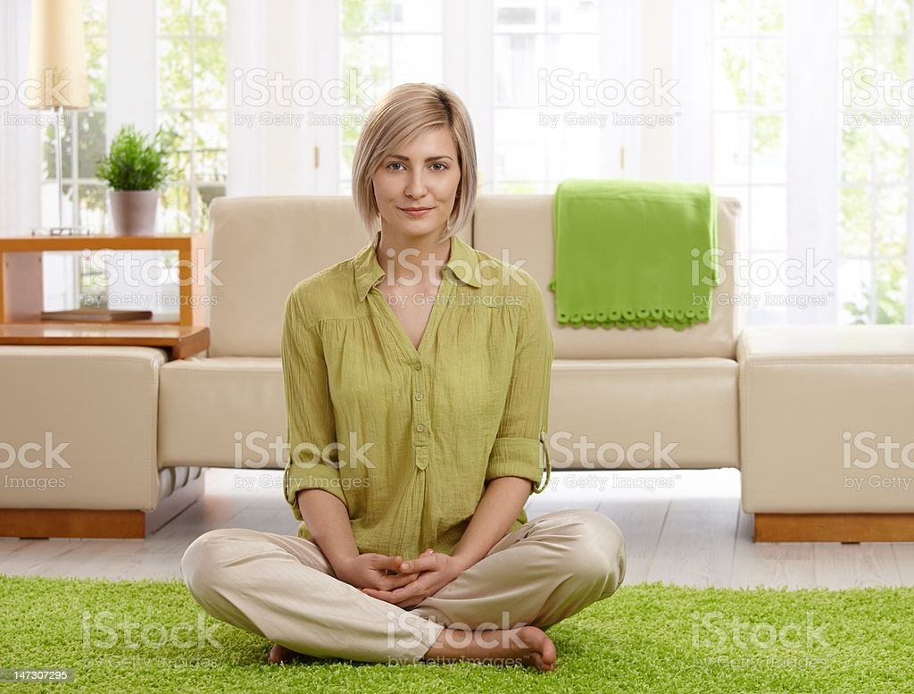 Woman on living room floor royalty-free stock photo