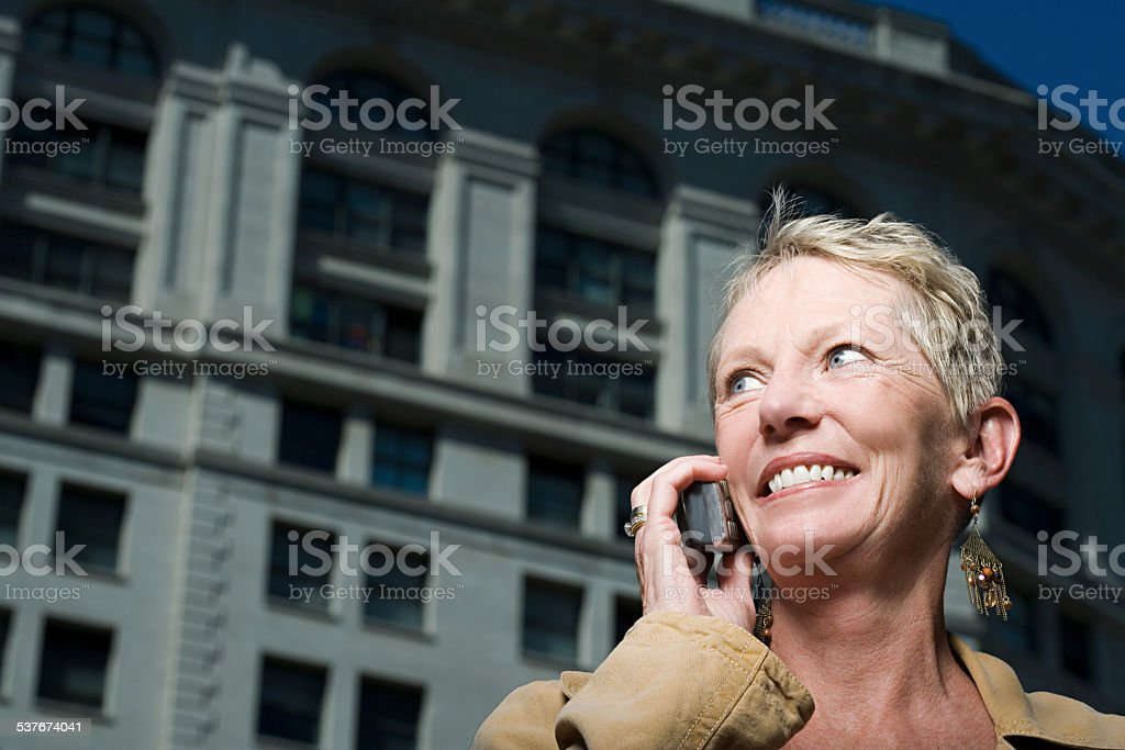 Woman on mobile phone stock photo
