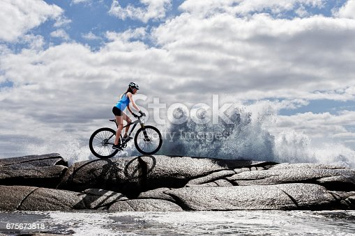 istock Woman on Mountain Bike 675673818