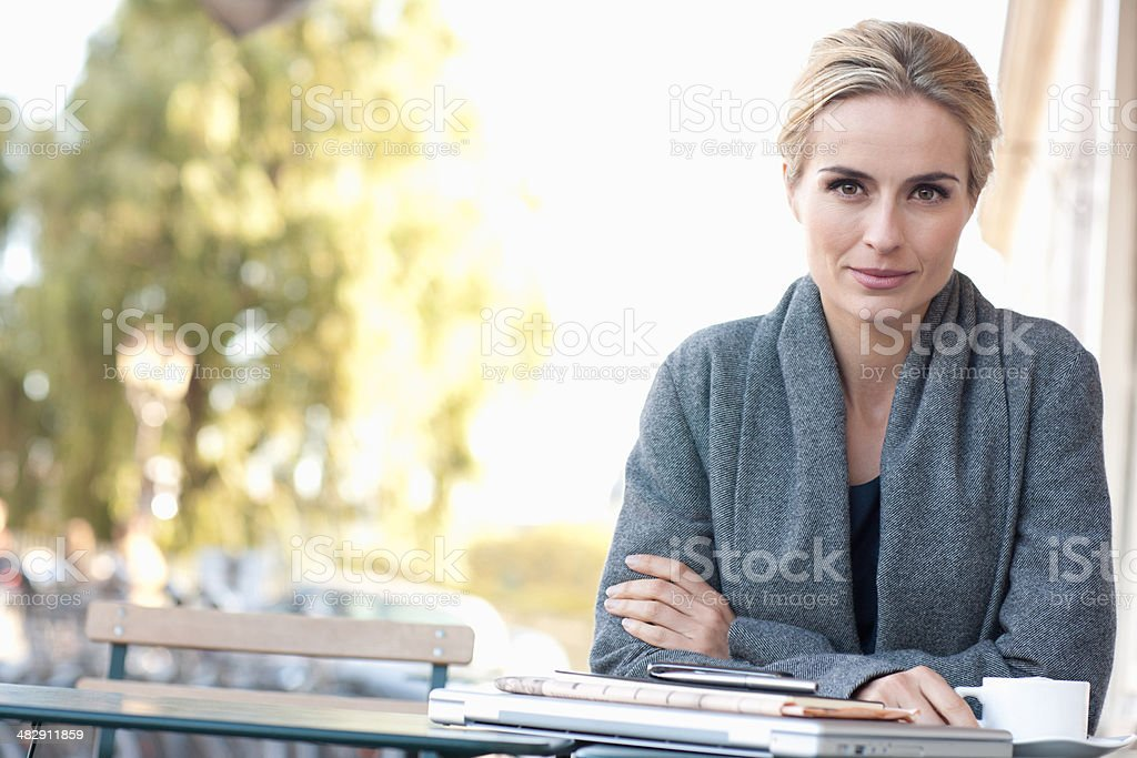 Woman on outdoor patio with coffee stock photo