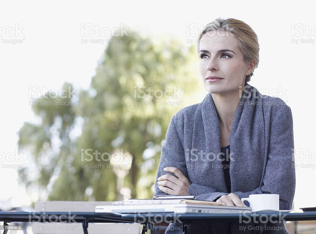 Woman on outdoor patio with mug royalty-free stock photo