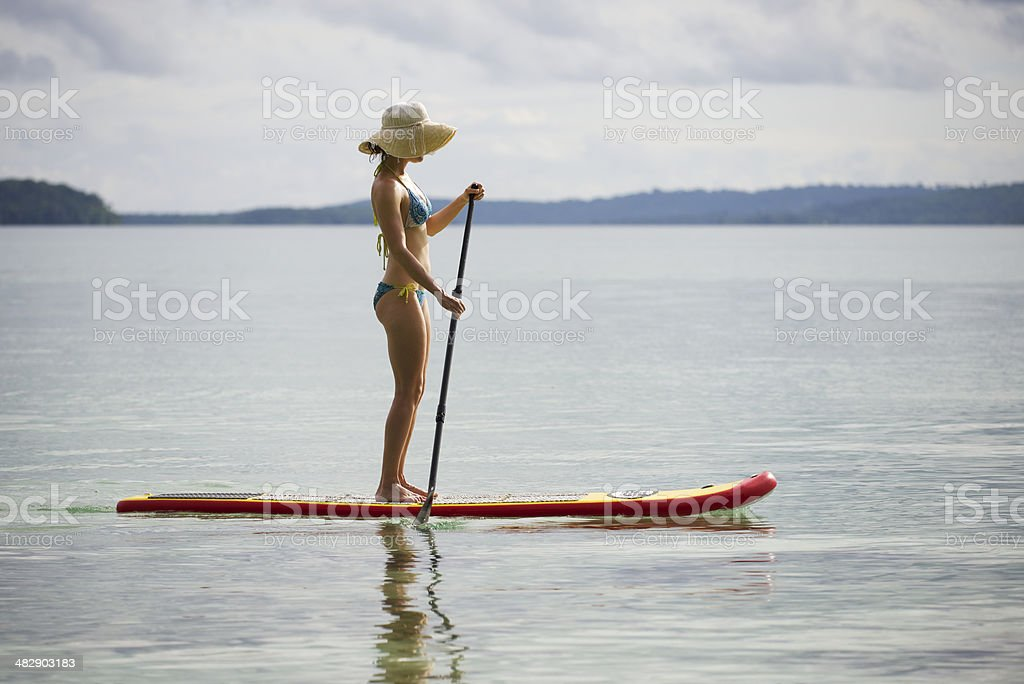 Woman on paddle board stock photo