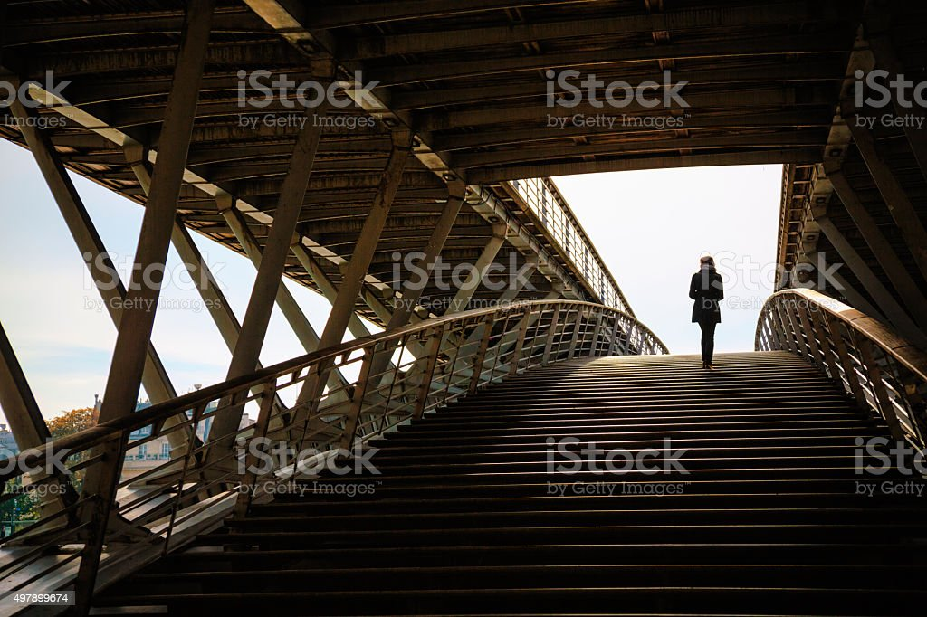Woman on Passerelle Solférino footbridge in Paris, France. stock photo