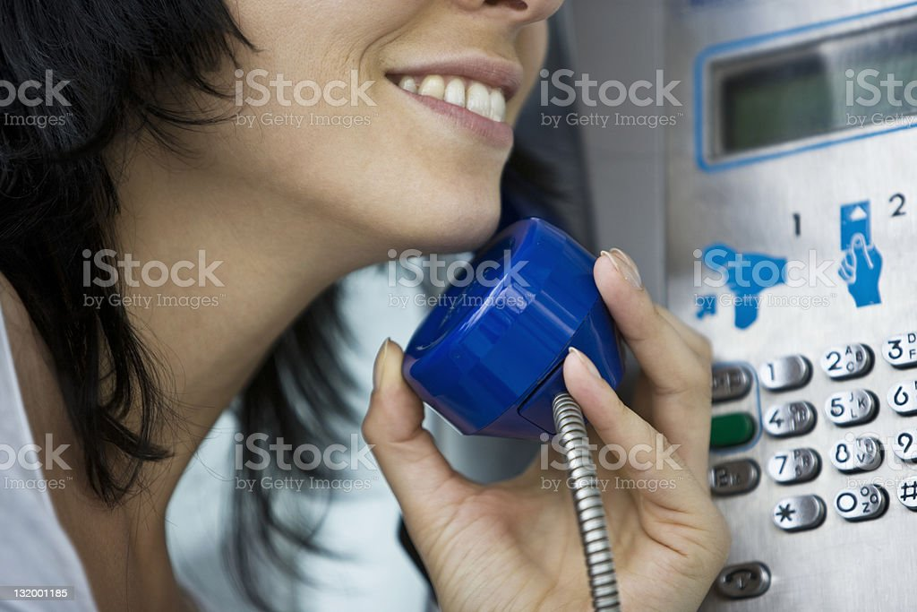 Woman on Pay phone royalty-free stock photo