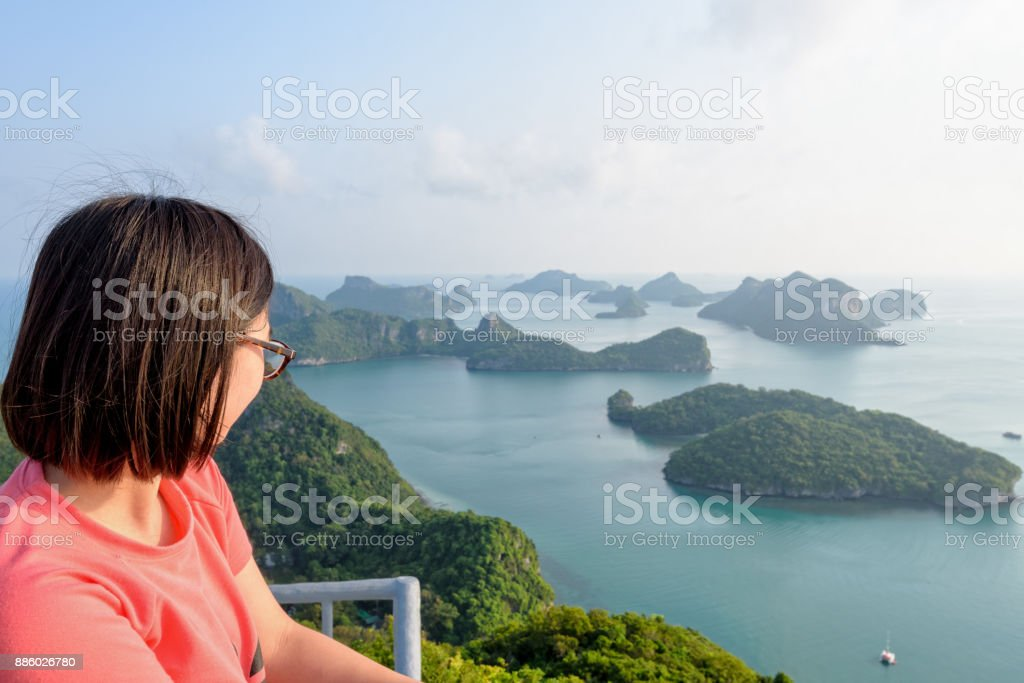 Woman on peak looking beautiful nature stock photo