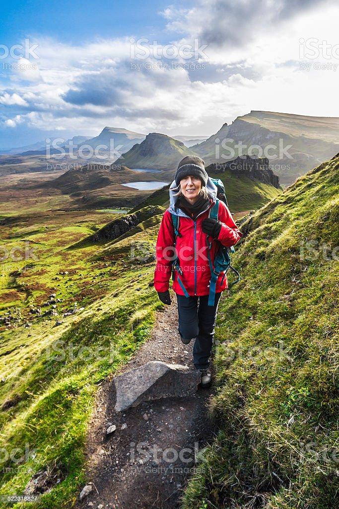 Woman on Quiraing Trail, Isle of Skye Scotland stock photo