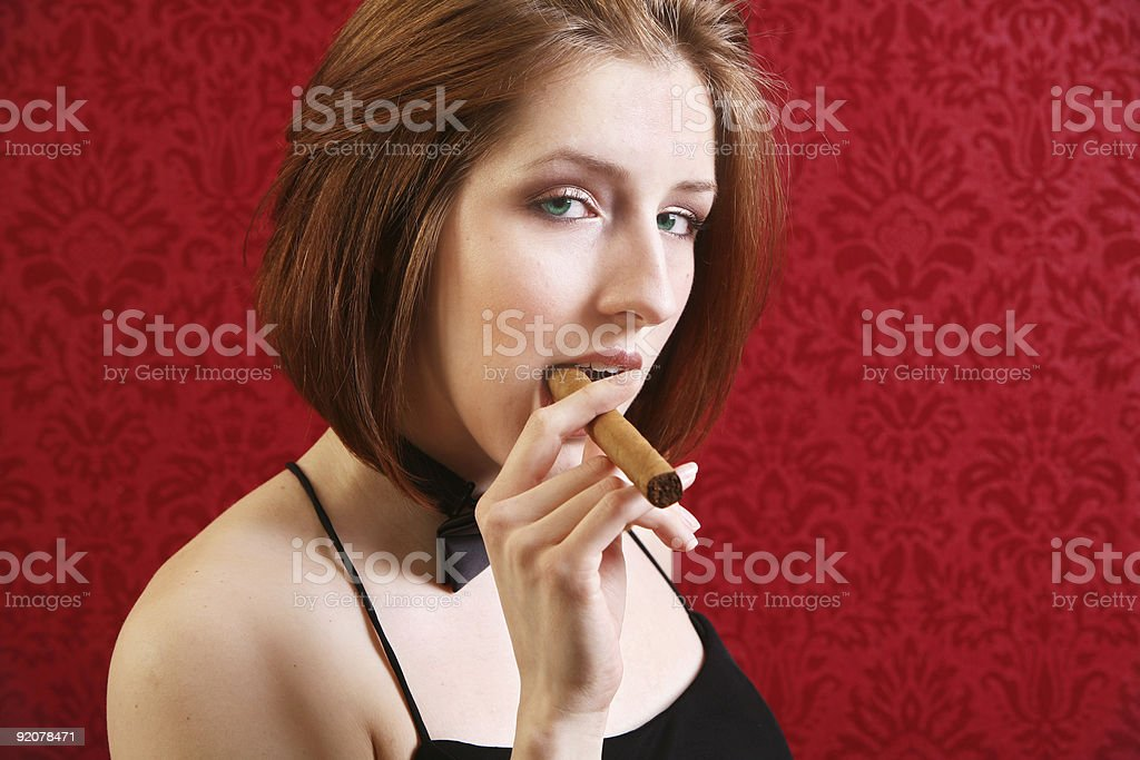 Woman on Red with Cigar royalty-free stock photo