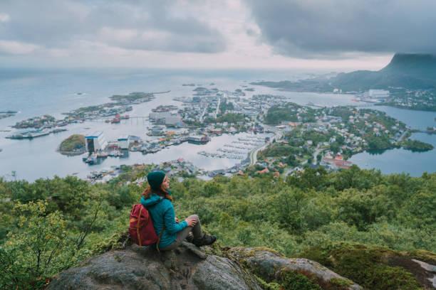 Woman on  Reinebringen mountain on Lofoten Island stock photo