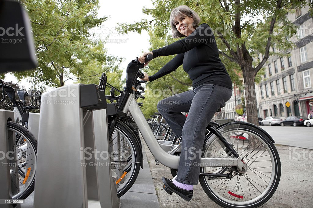 Woman on rent a Bicycle stock photo