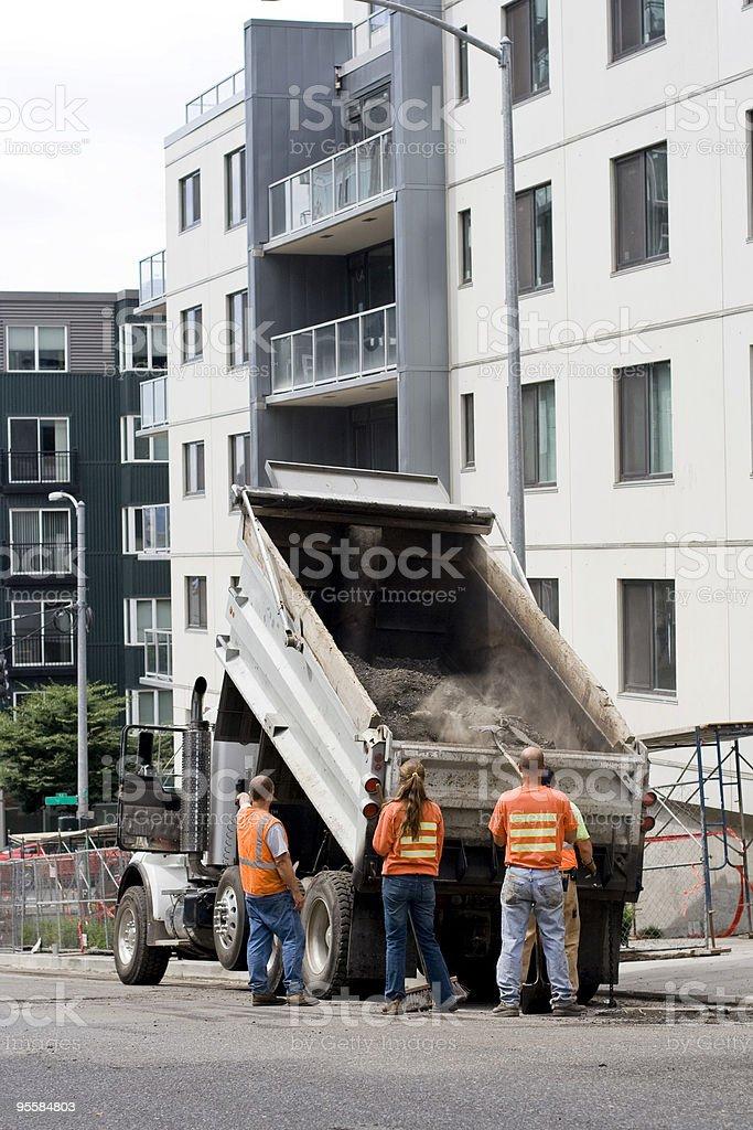 Woman on road construction crew stock photo