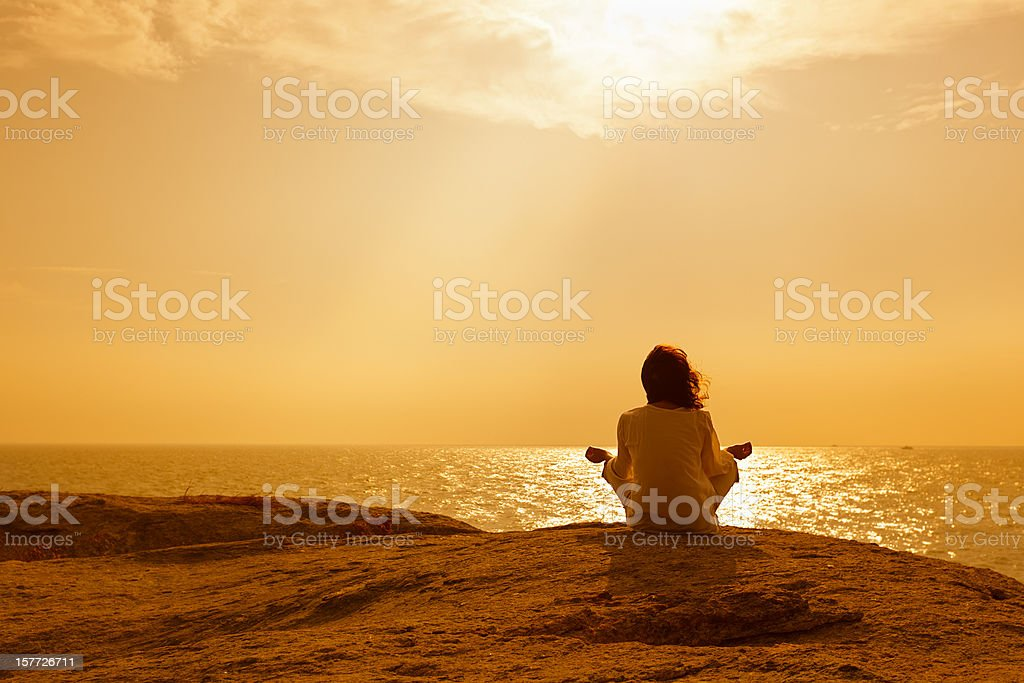 Woman on rock royalty-free stock photo