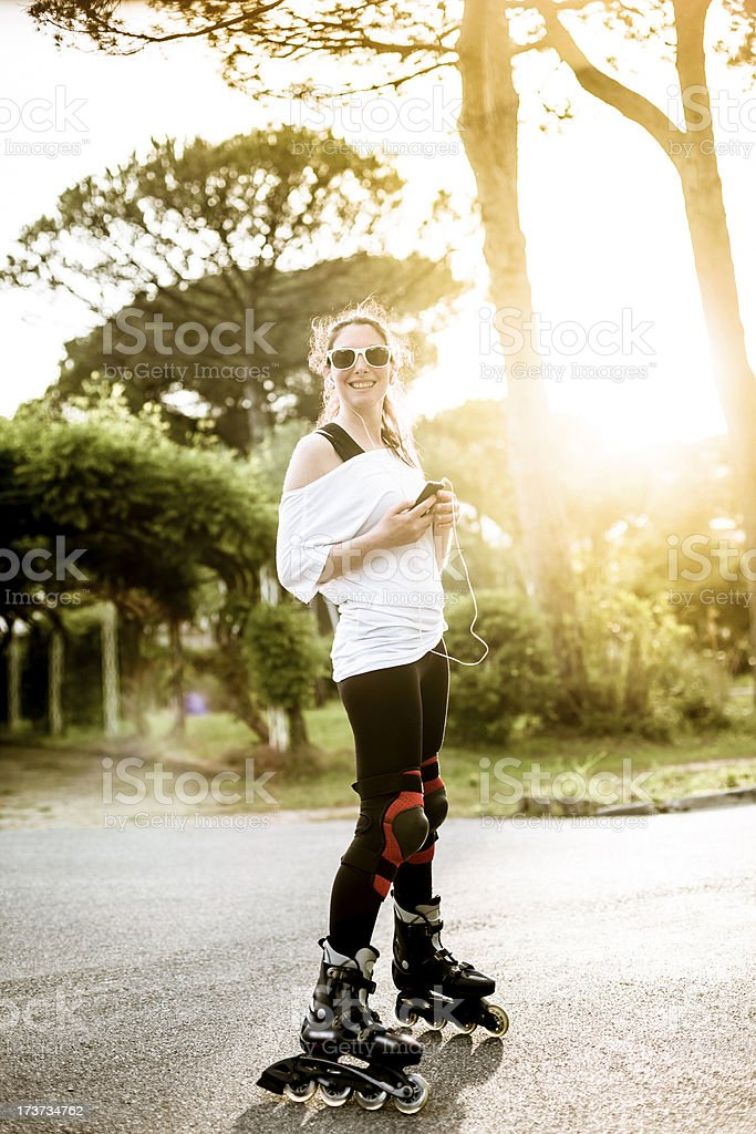 Woman on rollerblades royalty-free stock photo