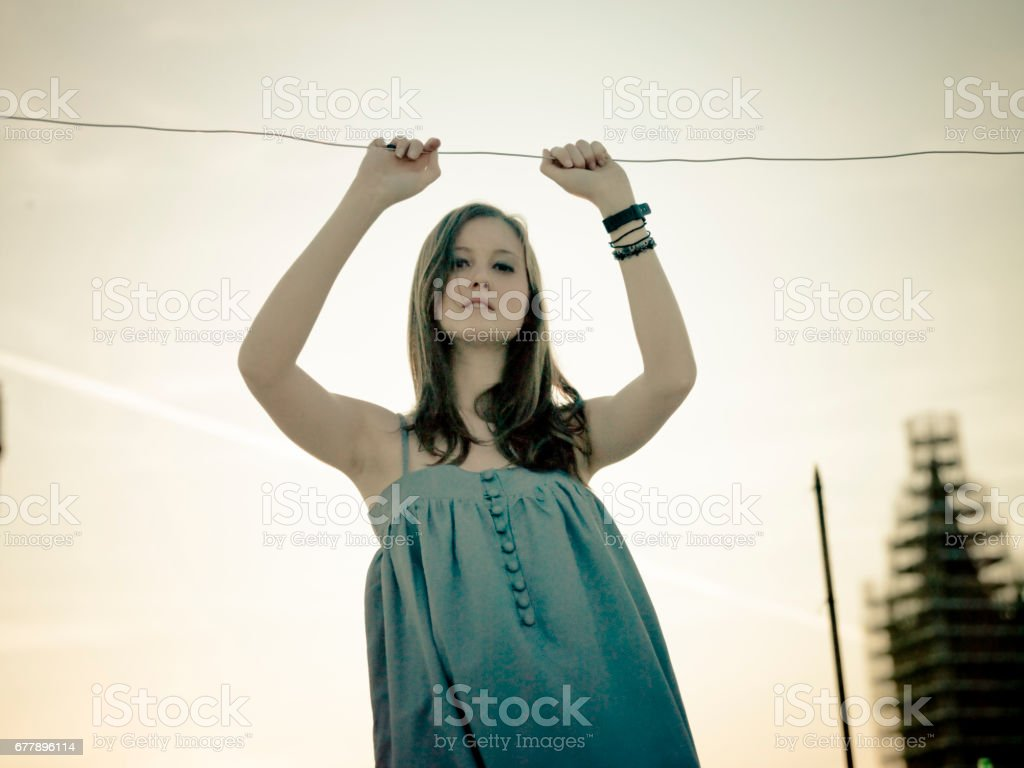 woman on rooftop royalty-free stock photo