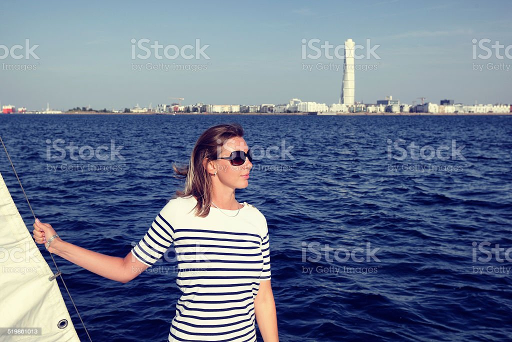 Woman on sailing yacht stock photo