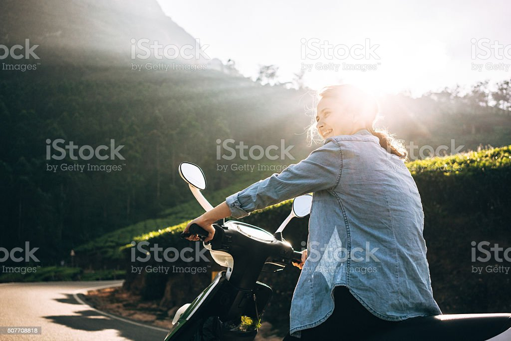 Woman on scooter stock photo