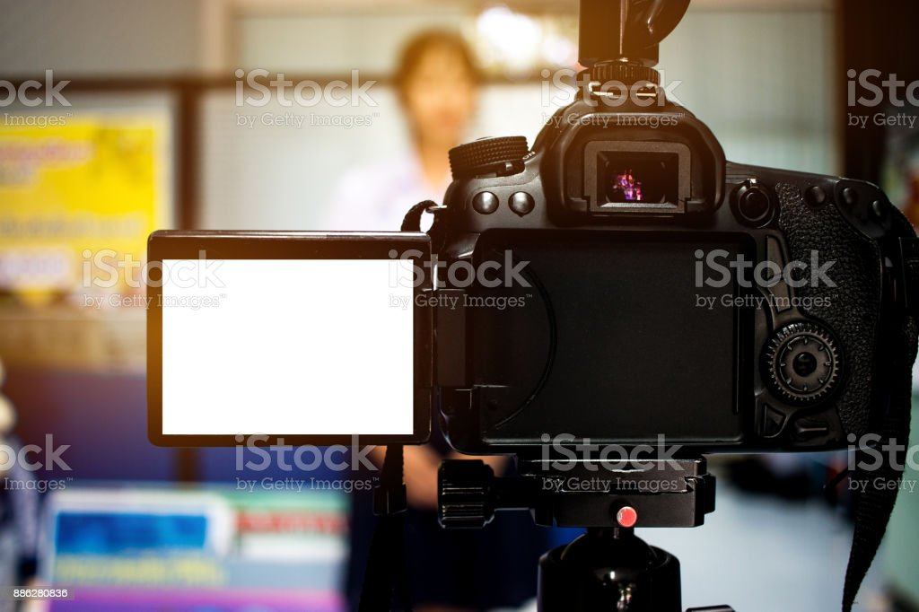 Woman On Set Video Camera Camcorder Interviews Operator Working For Record Speaker Or Presenter In Office Blak White Screen Interview Is Conversation Where Questions Are Asked And Answers Given Stock Photo