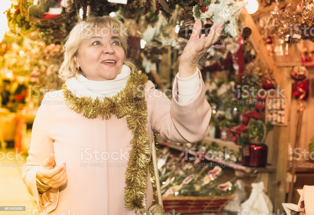 woman on shiny tinsel on New Year's Fair stock photo