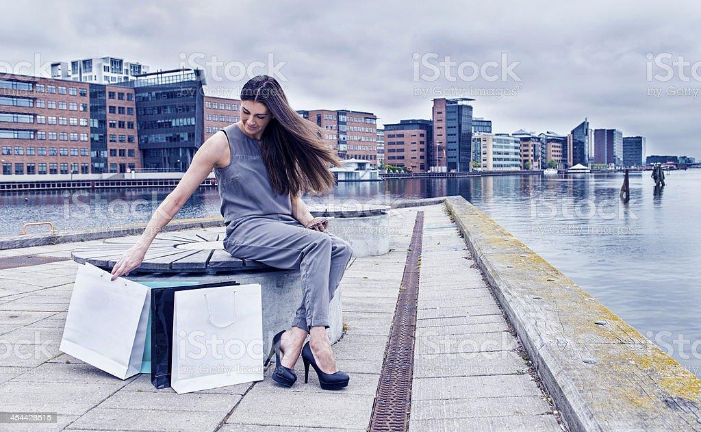 Woman on shopping trip near a harbor stock photo