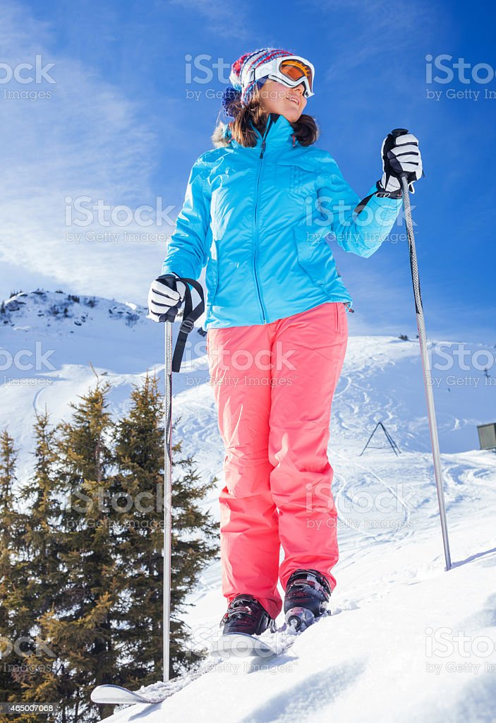 Woman On Ski Holiday In Mountains stock photo